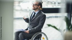 Photo: Businessman in a wheelchair; Copyright: PantherMedia / ArturVerkhovetskiy