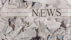 Photo: pieces of a newspaper with slogan